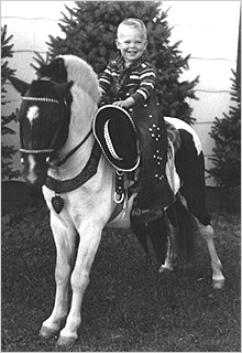 Photo of Michael Fitzgerald as a child, on a pony