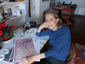 photo of Beatriz Vidal with some of her illustrations for Pine and Winter Sparrow