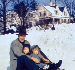 Photo of Demi with her sister and father in front of their old New England farmhouse